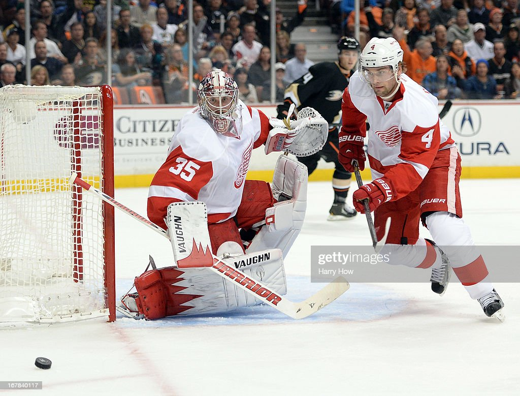 Jimmy Howard #35 of the Detroit Red Wings makes a save on a shot while Jakub Kindl #4 goes after the rebound during a 3-1 loss to the Anaheim Ducks in Game One of the Western Conference Quarterfinals during the 2013 Stanley Cup Playoffs at Honda Center on April 30, 2013 in Anaheim, California.