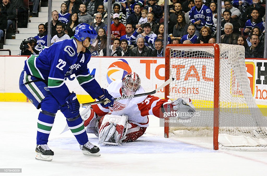 <a gi-track='captionPersonalityLinkClicked' href=/galleries/search?phrase=Jimmy+Howard&family=editorial&specificpeople=2118637 ng-click='$event.stopPropagation()'>Jimmy Howard</a> #35 of the Detroit Red Wings makes a save on <a gi-track='captionPersonalityLinkClicked' href=/galleries/search?phrase=Daniel+Sedin&family=editorial&specificpeople=202492 ng-click='$event.stopPropagation()'>Daniel Sedin</a> #22 of the Vancouver Canucks during their game at Rogers Arena on January 8, 2011 in Vancouver, British Columbia, Canada.
