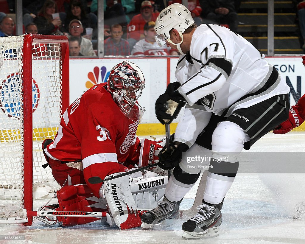 Jimmy Howard #35 of the Detroit Red Wings makes a save on Jeff Carter #77 of the Los Angeles Kings during a NHL game at Joe Louis Arena on April 24, 2013 in Detroit, Michigan.
