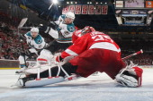 Jimmy Howard of the Detroit Red Wings makes a save on Logan Couture of the San Jose Sharks in Game Four of the Western Conference Semifinals in the...