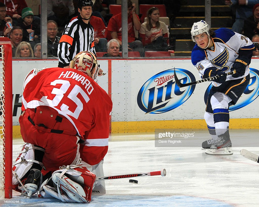 <a gi-track='captionPersonalityLinkClicked' href=/galleries/search?phrase=Jimmy+Howard&family=editorial&specificpeople=2118637 ng-click='$event.stopPropagation()'>Jimmy Howard</a> #35 of the Detroit Red Wings makes a save on <a gi-track='captionPersonalityLinkClicked' href=/galleries/search?phrase=T.J.+Oshie&family=editorial&specificpeople=700383 ng-click='$event.stopPropagation()'>T.J. Oshie</a> #74 of the St Louis Blues during a NHL game at Joe Louis Arena on February 1, 2013 in Detroit, Michigan.