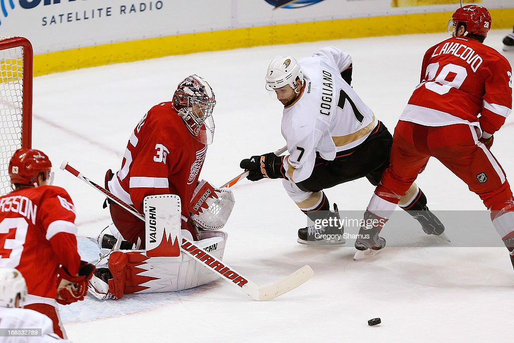 <a gi-track='captionPersonalityLinkClicked' href=/galleries/search?phrase=Jimmy+Howard&family=editorial&specificpeople=2118637 ng-click='$event.stopPropagation()'>Jimmy Howard</a> #35 of the Detroit Red Wings makes a second-period save on <a gi-track='captionPersonalityLinkClicked' href=/galleries/search?phrase=Andrew+Cogliano&family=editorial&specificpeople=869296 ng-click='$event.stopPropagation()'>Andrew Cogliano</a> #7 of the Anaheim Ducks in Game Six of the Western Conference Quarterfinals during the 2013 NHL Stanley Cup Playoffs at Joe Louis Arena on May 10, 2013 in Detroit, Michigan.