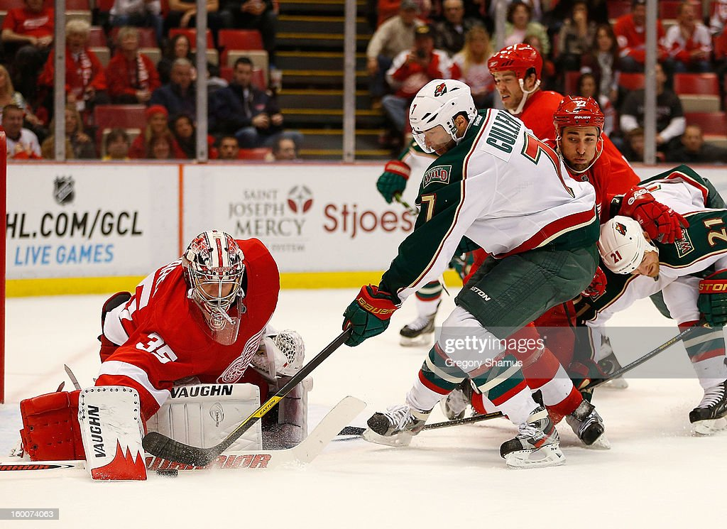 <a gi-track='captionPersonalityLinkClicked' href=/galleries/search?phrase=Jimmy+Howard&family=editorial&specificpeople=2118637 ng-click='$event.stopPropagation()'>Jimmy Howard</a> #35 of the Detroit Red Wings makes a third period save on <a gi-track='captionPersonalityLinkClicked' href=/galleries/search?phrase=Matt+Cullen&family=editorial&specificpeople=536122 ng-click='$event.stopPropagation()'>Matt Cullen</a> #7 of the Minnesota Wild at Joe Louis Arena on January 25, 2013 in Detroit, Michigan. Detroit won the game 5-3.