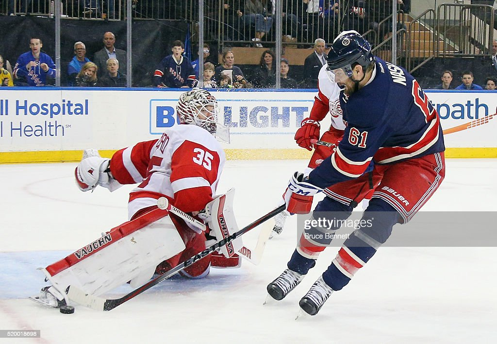 <a gi-track='captionPersonalityLinkClicked' href=/galleries/search?phrase=Jimmy+Howard&family=editorial&specificpeople=2118637 ng-click='$event.stopPropagation()'>Jimmy Howard</a> #35 of the Detroit Red Wings makes the second period save against <a gi-track='captionPersonalityLinkClicked' href=/galleries/search?phrase=Rick+Nash&family=editorial&specificpeople=202196 ng-click='$event.stopPropagation()'>Rick Nash</a> #61 of the New York Rangers at Madison Square Garden on April 9, 2016 in New York City.