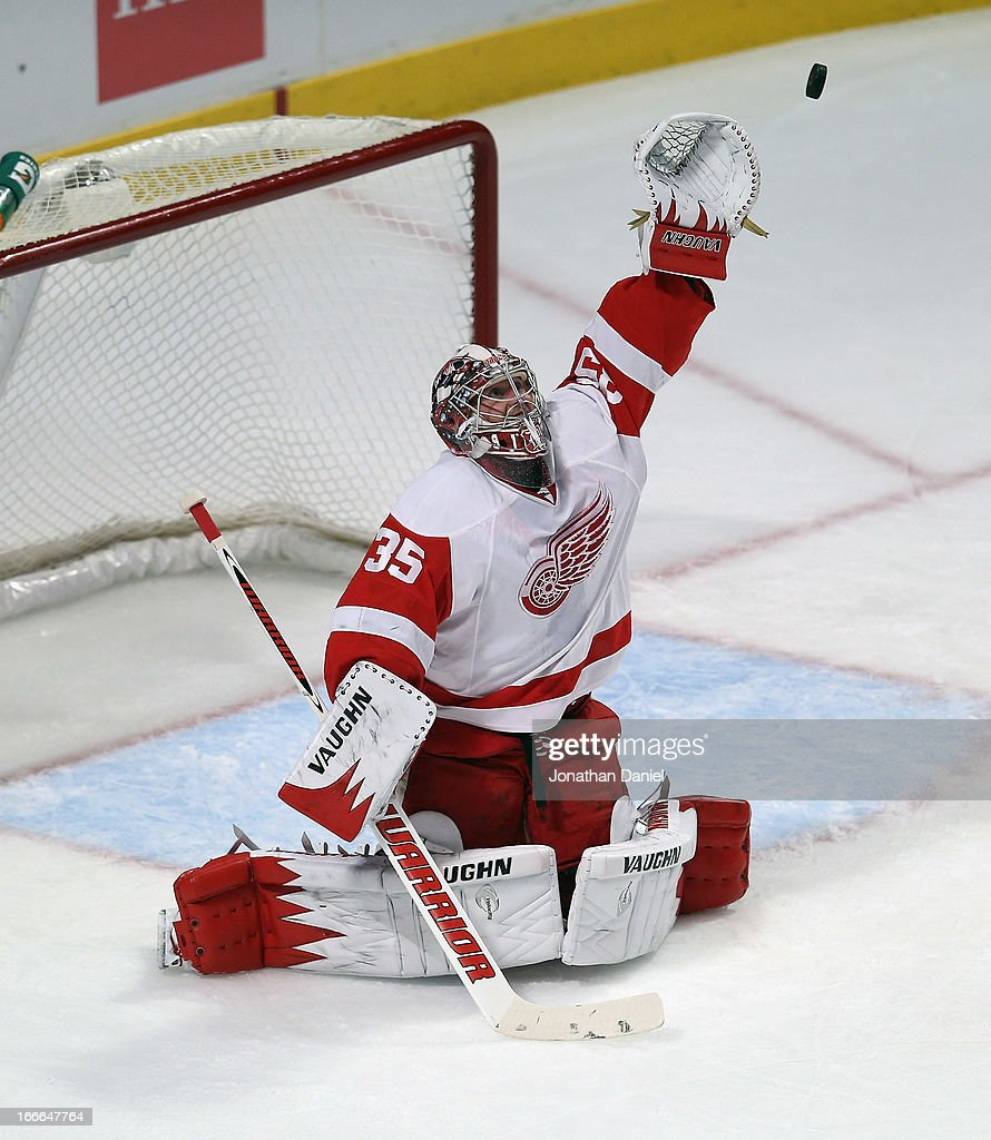 <a gi-track='captionPersonalityLinkClicked' href=/galleries/search?phrase=Jimmy+Howard&family=editorial&specificpeople=2118637 ng-click='$event.stopPropagation()'>Jimmy Howard</a> #35 of the Detroit Red Wings reaches for the puck against the Chicago Blackhawks at the United Center on April 12, 2013 in Chicago, Illinois. The Blackhawks defeated the Red Wings 3-2 in a shootout.