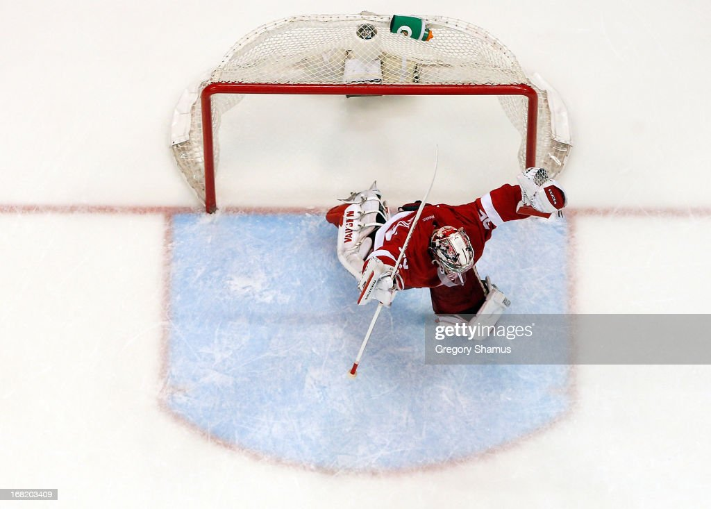 <a gi-track='captionPersonalityLinkClicked' href=/galleries/search?phrase=Jimmy+Howard&family=editorial&specificpeople=2118637 ng-click='$event.stopPropagation()'>Jimmy Howard</a> #35 of the Detroit Red Wings reacts to a 3-2 overtime win against the Anaheim Ducks in Game Four of the Western Conference Quarterfinals during the 2013 NHL Stanley Cup Playoffs at Joe Louis Arena on May 6, 2013 in Detroit, Michigan.