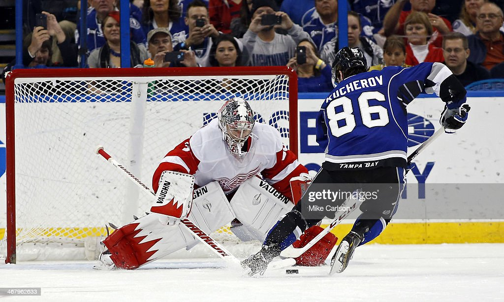 <a gi-track='captionPersonalityLinkClicked' href=/galleries/search?phrase=Jimmy+Howard&family=editorial&specificpeople=2118637 ng-click='$event.stopPropagation()'>Jimmy Howard</a> #35 of the Detroit Red Wings saves a penalty shot by Nikita Kucherov #86 of the Tampa Bay Lightning at the Tampa Bay Times Forum on February 8, 2014 in Tampa, Florida.
