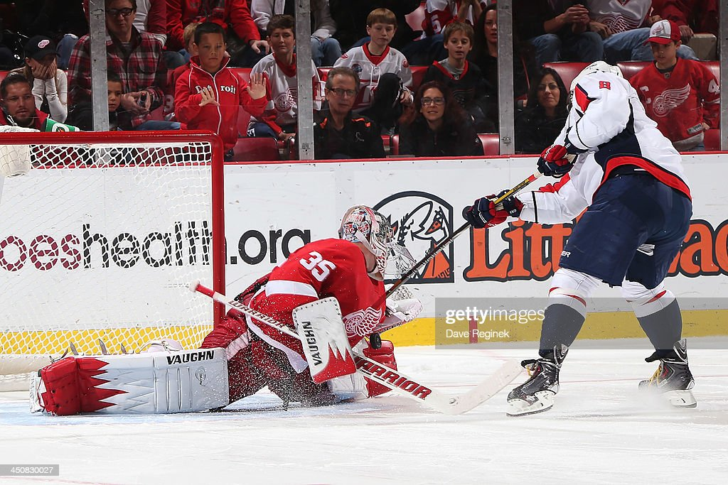 Jimmy Howard #35 of the Detroit Red Wings stops Alex Ovechkin #8 of the Washington Capitals on his shoot-out attempt during an NHL game at Joe Louis Arena on November 15, 2013 in Detroit, Michigan.