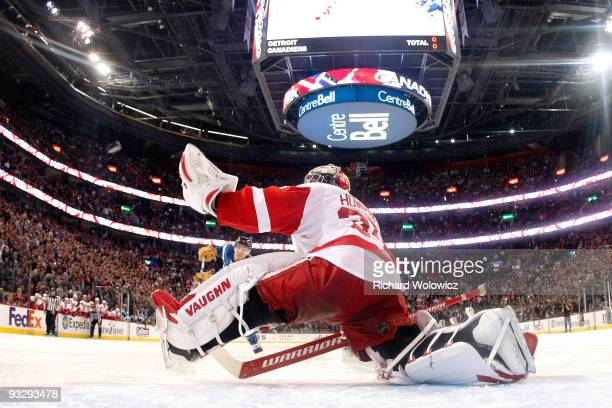 Jimmy Howard of the Detroit Red Wings stretches out to stop the puck on the shootout attempt by Mike Cammalleri of the Montreal Canadiens during the...