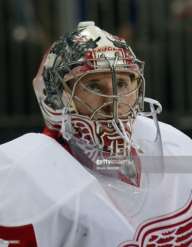 <a gi-track='captionPersonalityLinkClicked' href=/galleries/search?phrase=Jimmy+Howard&family=editorial&specificpeople=2118637 ng-click='$event.stopPropagation()'>Jimmy Howard</a> #35 of the Detroit Red Wings takes a break during the game against the New York Rangers at Madison Square Garden on January 16, 2014 in New York City. The Rangers shutout the Red Wings 1-0.