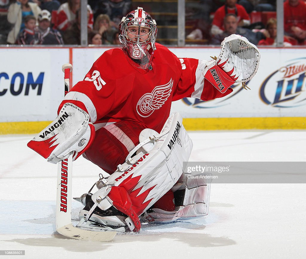 <a gi-track='captionPersonalityLinkClicked' href=/galleries/search?phrase=Jimmy+Howard&family=editorial&specificpeople=2118637 ng-click='$event.stopPropagation()'>Jimmy Howard</a> #35 of the Detroit Red Wings turns a shot away in a game against the Columbus Blue Jackets on February 4, 2011 at the Joe Louis Arena in Detroit, Michigan. The Blue Jackets defeated the Wings 3-0.