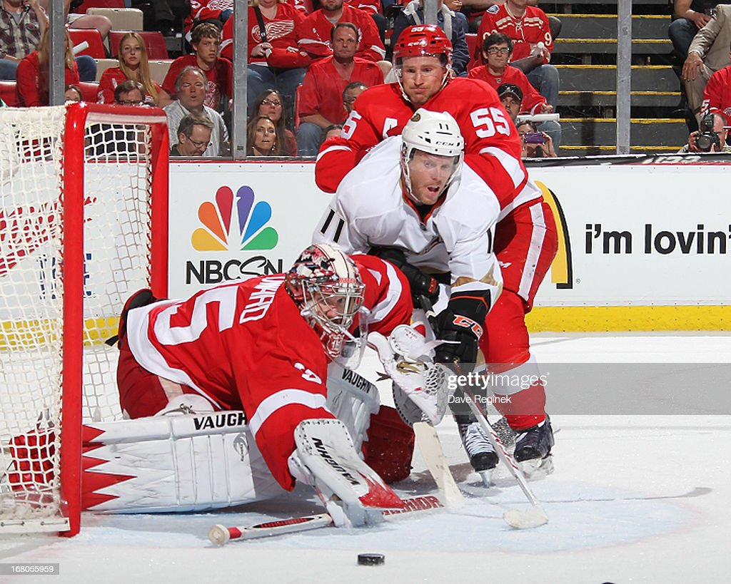 <a gi-track='captionPersonalityLinkClicked' href=/galleries/search?phrase=Jimmy+Howard&family=editorial&specificpeople=2118637 ng-click='$event.stopPropagation()'>Jimmy Howard</a> #35 of the Detroit Red Wings watches the puck in front of the net as <a gi-track='captionPersonalityLinkClicked' href=/galleries/search?phrase=Niklas+Kronwall&family=editorial&specificpeople=220826 ng-click='$event.stopPropagation()'>Niklas Kronwall</a> #55 of the the Detroit Red Wings put a body on <a gi-track='captionPersonalityLinkClicked' href=/galleries/search?phrase=Saku+Koivu&family=editorial&specificpeople=202253 ng-click='$event.stopPropagation()'>Saku Koivu</a> #11 of the Anaheim Ducks during Game Three of the Western Conference Quarterfinals at Joe Louis Arena on May 4, 2013 in Detroit, Michigan.