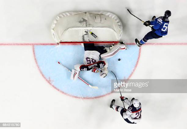 Jimmy Howard of the USA saves a shot by Juhamatti Aaltonen of Finlandk during the 2017 IIHF Ice Hockey World Championship quarter final game between...