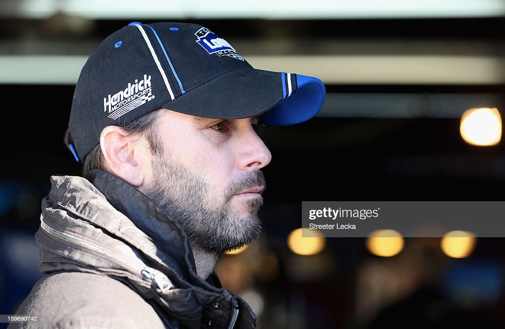 Jimmy Johnson, driver of the #48 Lowes, looks around in the garage during NASCAR Testing at Charlotte Motor Speedway on January 18, 2013 in Charlotte, North Carolina.