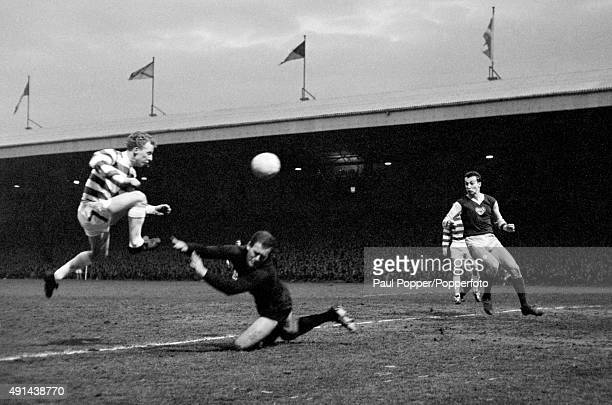 Jimmy Johnstone beats the Dukla Prague goalkeeper Ivo Viktor to score Celtic's first goal during the European Cup SemiFinal 1st leg at Celtic Park in...