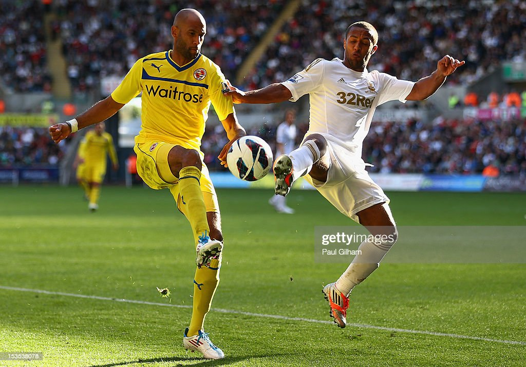 <a gi-track='captionPersonalityLinkClicked' href=/galleries/search?phrase=Jimmy+Kebe&family=editorial&specificpeople=2953929 ng-click='$event.stopPropagation()'>Jimmy Kebe</a> of Reading battles for the ball with <a gi-track='captionPersonalityLinkClicked' href=/galleries/search?phrase=Wayne+Routledge&family=editorial&specificpeople=206672 ng-click='$event.stopPropagation()'>Wayne Routledge</a> of Swansea City during the Barclays Premier League match between Swansea City and Reading at the Liberty Stadium on October 6, 2012 in Swansea, Wales.