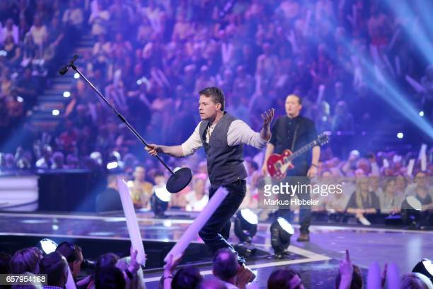 Jimmy Kelly performs during the show 'Schlagercountdown Das grosse Premierenfest' at EWE Arena on March 25 2017 in Oldenburg Germany