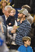 Jimmy Kimmel and his daughter Jane Kimmel attend a baseball game between the New York Mets and the Los Angeles Dodgers at Dodger Stadium on May 10...