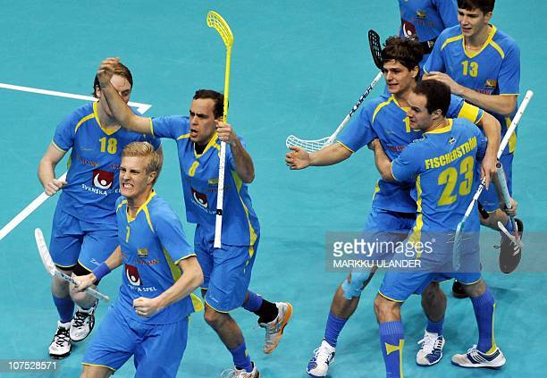 Jimmy Lindblom raises his stick to celebrate after the opening goal for his team during the World Floorball Championship 2010 final between Finland...