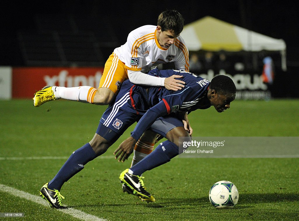 Jimmy Nealis #45 of the Houston Dynamo and Jalil Anibaba #6 of the Chicago Fire battle for the ball during the second half of their game in the Carolina Challenge Cup at Blackbaud Stadium on February 16, 2013 in Charleston, South Carolina.