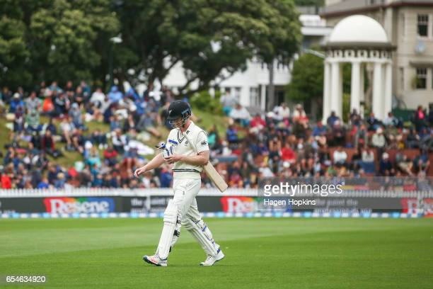 Jimmy Neesham of New Zealand leaves the field after being dismissed during day three of the test match between New Zealand and South Africa at Basin...