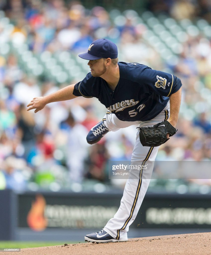 Jimmy Nelson #52 of the Milwaukee Brewers pitches to Jose Reyes #7 of the Toronto Blue Jays at Miller Park on August 20, 2014 in Milwaukee, Wisconsin.