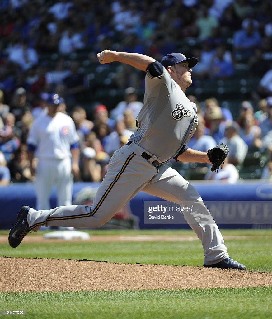 Jimmy Nelson #52 of the Milwaukee Brewers pitchs against the Chicago Cubs during the first inning on September 1, 2014 at Wrigley Field in Chicago, Illinois.