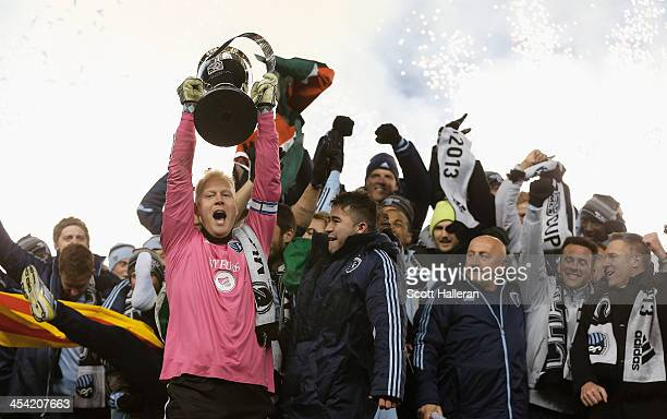 Jimmy Nielsen of Sporting KC celebrates with the Philip F Anschutz trophy and his teammates after defeating Real Salt Lake in penalty kicks to win...