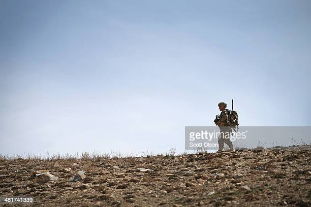 Jimmy Orrell from Claremore Oklahoma with the US Army's 2nd Battalion 87th Infantry Regiment 3rd Brigade Combat Team 10th Mountain Division walks...