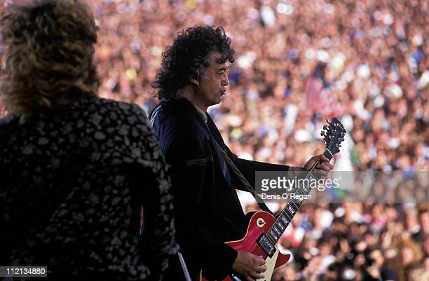 Jimmy Page and Robert Plant of Led Zeppelin live at Knebworth 1990
