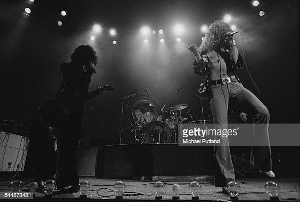 Jimmy Page and Robert Plant performing with British heavy rock group Led Zeppelin at Earl's Court London May 1975 John Bonham is behind the kit The...