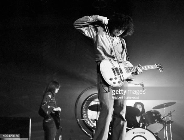 Jimmy Page of Led Zeppelin plays a Gibson Les Paul Standard guitar with a violin bow while performing on stage at Oude Rai on 27th May 1972 in...