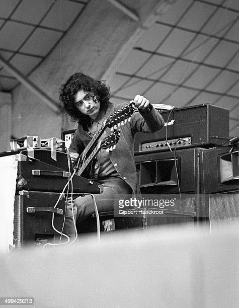 Jimmy Page of Led Zeppelin tunes his guitar on stage during a soundcheck at Oude Rai on 27th May 1972 in Amsterdam Netherlands
