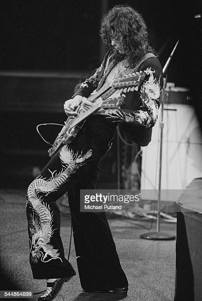 Jimmy Page playing a double neck guitar on stage with British heavy rock group Led Zeppelin at Earl's Court London May 1975 The band were initially...