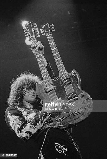 Jimmy Page playing a Gibson double neck guitar on stage with British heavy rock group Led Zeppelin at Earl's Court London May 1975 The band were...