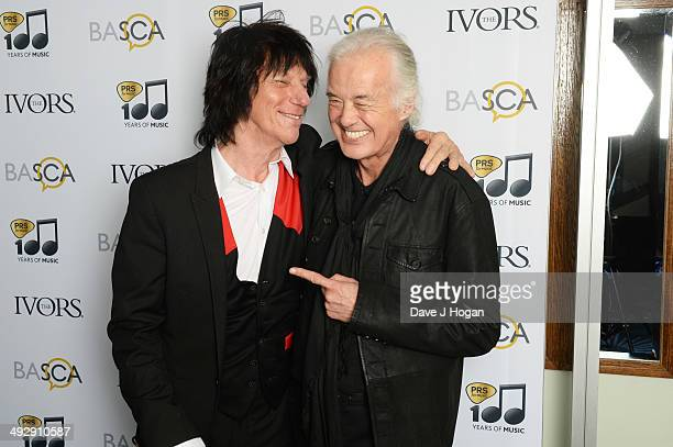 Jimmy Page poses with Jeff Beck after presenting him with his 'Outstanding Contribution To British Music' award in the winners room at The Ivor...