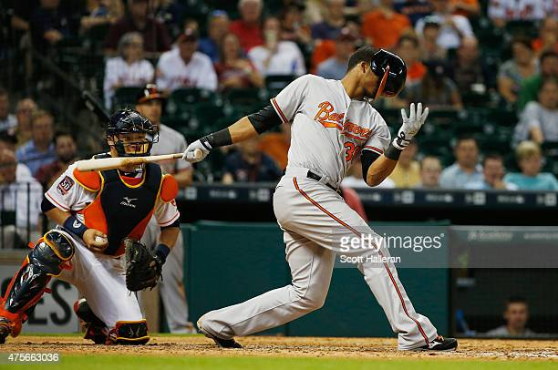 Jimmy Paredes of the Baltimore Orioles strikes out swinging in the ninth inning during their game against the Houston Astros at Minute Maid Park on...