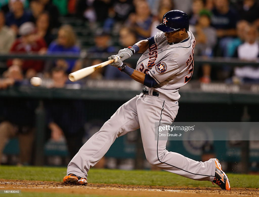 Jimmy Paredes #38 of the Houston Astros hits a game-tying double in the ninth inning against the Seattle Mariners at Safeco Field on September 9, 2013 in Seattle, Washington.