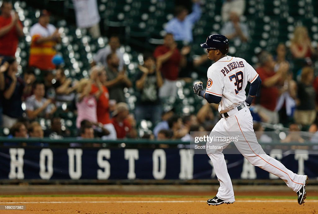 Jimmy Paredes #38 of the Houston Astros rounds third base after his three-run home run to right field during the fourth inning against the Kansas City Royals at Minute Maid Park on May 21, 2013 in Houston, Texas.