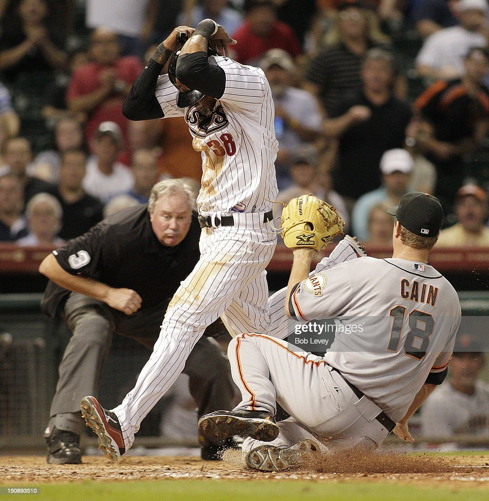 Jimmy Paredes #38 of the Houston Astros scores in the eighth inning on a wild pitch by pitcher <a gi-track='captionPersonalityLinkClicked' href=/galleries/search?phrase=Matt+Cain&family=editorial&specificpeople=534602 ng-click='$event.stopPropagation()'>Matt Cain</a> #18 of the San Francisco Giants at Minute Maid Park on August 28, 2012 in Houston, Texas.