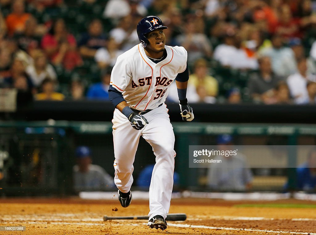 Jimmy Paredes #38 of the Houston Astros watches his three-run home run to right field during the fourth inning against the Kansas City Royals at Minute Maid Park on May 21, 2013 in Houston, Texas.