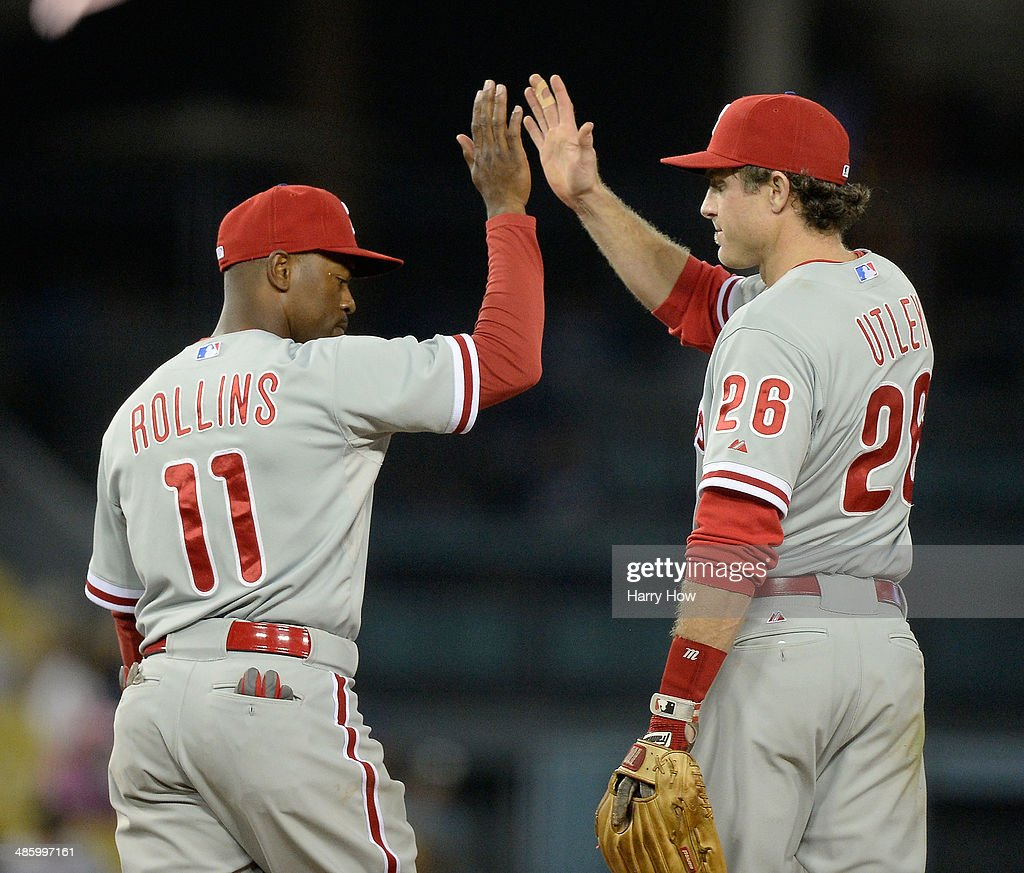 <a gi-track='captionPersonalityLinkClicked' href=/galleries/search?phrase=Jimmy+Rollins&family=editorial&specificpeople=204478 ng-click='$event.stopPropagation()'>Jimmy Rollins</a> #11 and <a gi-track='captionPersonalityLinkClicked' href=/galleries/search?phrase=Chase+Utley&family=editorial&specificpeople=161391 ng-click='$event.stopPropagation()'>Chase Utley</a> #26 of the Philadelphia Phillies celebrate a 7-0 win over the Los Angeles Dodgers at Dodger Stadium on April 21, 2014 in Los Angeles, California.