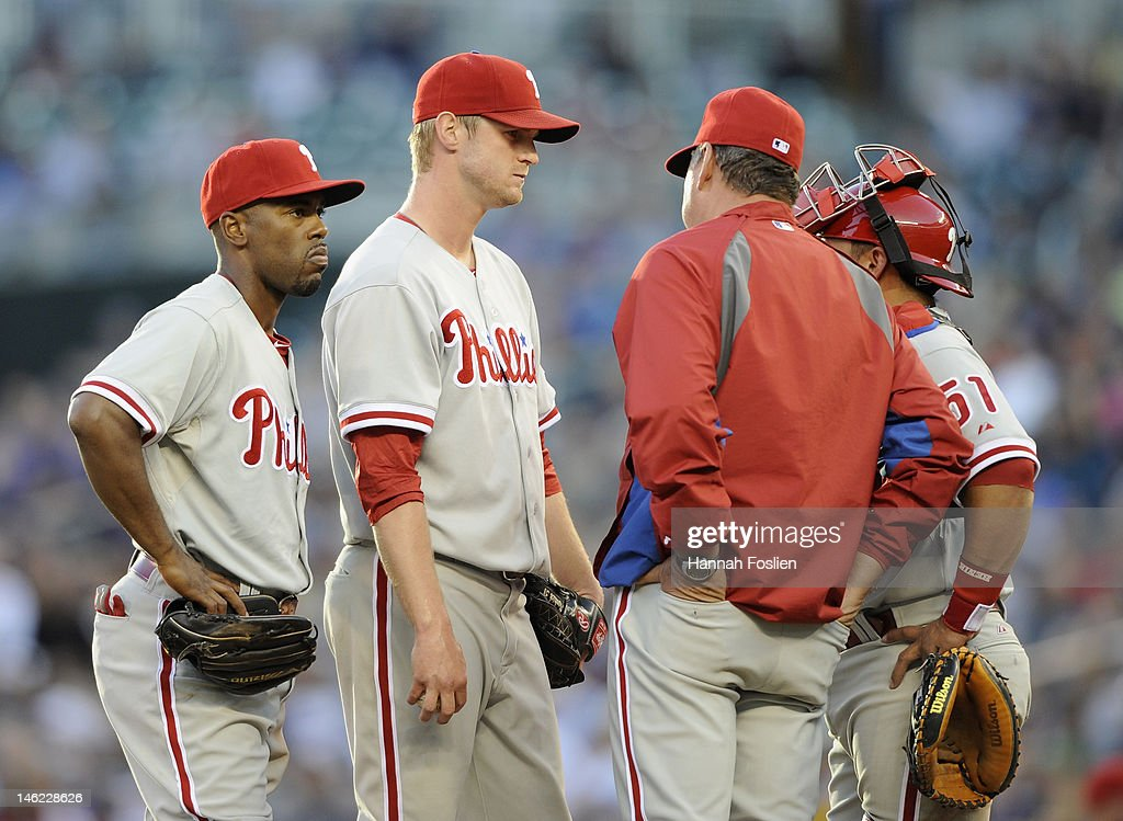 <a gi-track='captionPersonalityLinkClicked' href=/galleries/search?phrase=Jimmy+Rollins&family=editorial&specificpeople=204478 ng-click='$event.stopPropagation()'>Jimmy Rollins</a> #11, <a gi-track='captionPersonalityLinkClicked' href=/galleries/search?phrase=Kyle+Kendrick&family=editorial&specificpeople=4365300 ng-click='$event.stopPropagation()'>Kyle Kendrick</a> #38, Rich Dubee #30 and Carlos Ruiz #51 of the Philadelphia Phillies speak on the mound during the second inning against the Minnesota Twins on June 12, 2012 at Target Field in Minneapolis, Minnesota.