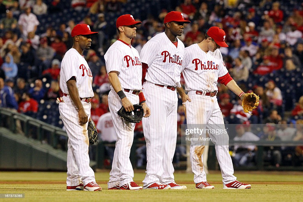 <a gi-track='captionPersonalityLinkClicked' href=/galleries/search?phrase=Jimmy+Rollins&family=editorial&specificpeople=204478 ng-click='$event.stopPropagation()'>Jimmy Rollins</a> #11, <a gi-track='captionPersonalityLinkClicked' href=/galleries/search?phrase=Michael+Young+-+Baseball+Player&family=editorial&specificpeople=203149 ng-click='$event.stopPropagation()'>Michael Young</a> #10, <a gi-track='captionPersonalityLinkClicked' href=/galleries/search?phrase=Ryan+Howard&family=editorial&specificpeople=551402 ng-click='$event.stopPropagation()'>Ryan Howard</a> #6 and <a gi-track='captionPersonalityLinkClicked' href=/galleries/search?phrase=Chase+Utley&family=editorial&specificpeople=161391 ng-click='$event.stopPropagation()'>Chase Utley</a> #26 of the Philadelphia Phillies stand together in the eighth inning during a pitching change during a game against the Pittsburgh Pirates at Citizens Bank Park on April 24, 2013 in Philadelphia, Pennsylvania. The Pirates won 5-3.