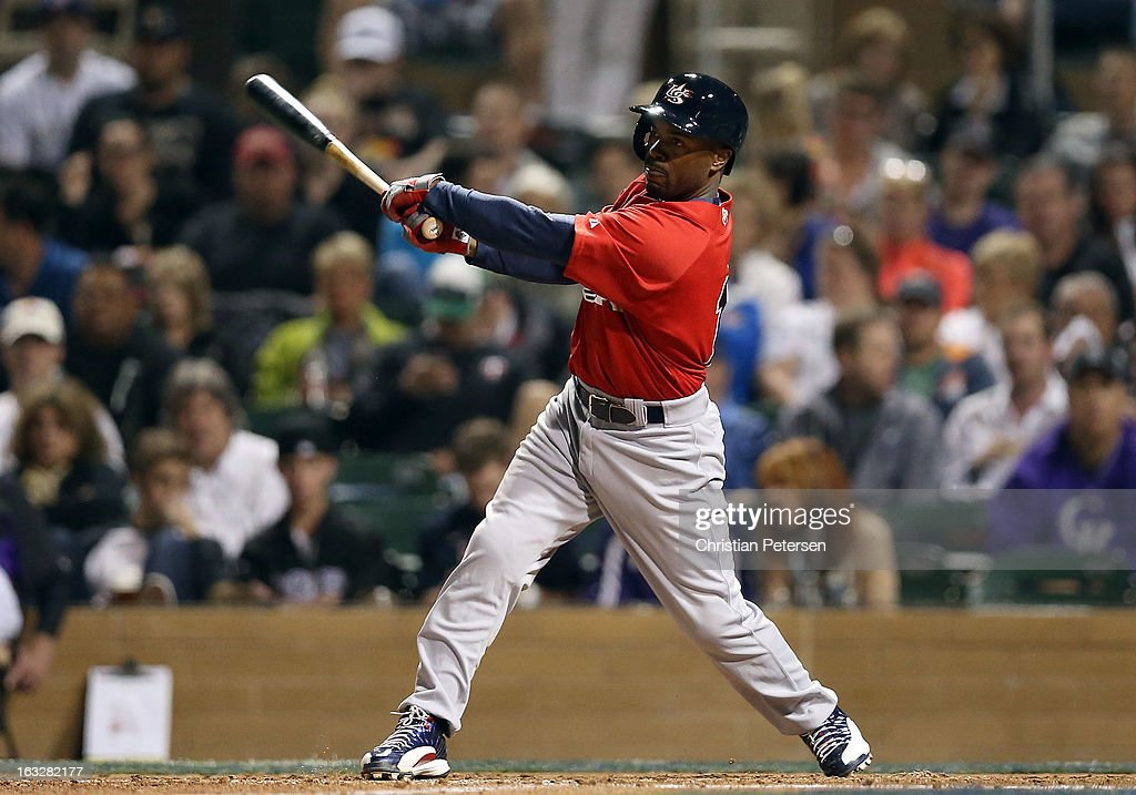 <a gi-track='captionPersonalityLinkClicked' href=/galleries/search?phrase=Jimmy+Rollins&family=editorial&specificpeople=204478 ng-click='$event.stopPropagation()'>Jimmy Rollins</a> #11 of Team USA hits a single against the Colorado Rockies during the fourth inning of the spring training game at Salt River Fields at Talking Stick on March 6, 2013 in Scottsdale, Arizona.