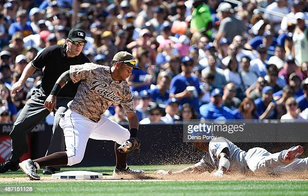 Jimmy Rollins of the Los Angeles Dodgers is tagged out by Yangervis Solarte of the San Diego Padres as he tries to steal third base during the fifth...