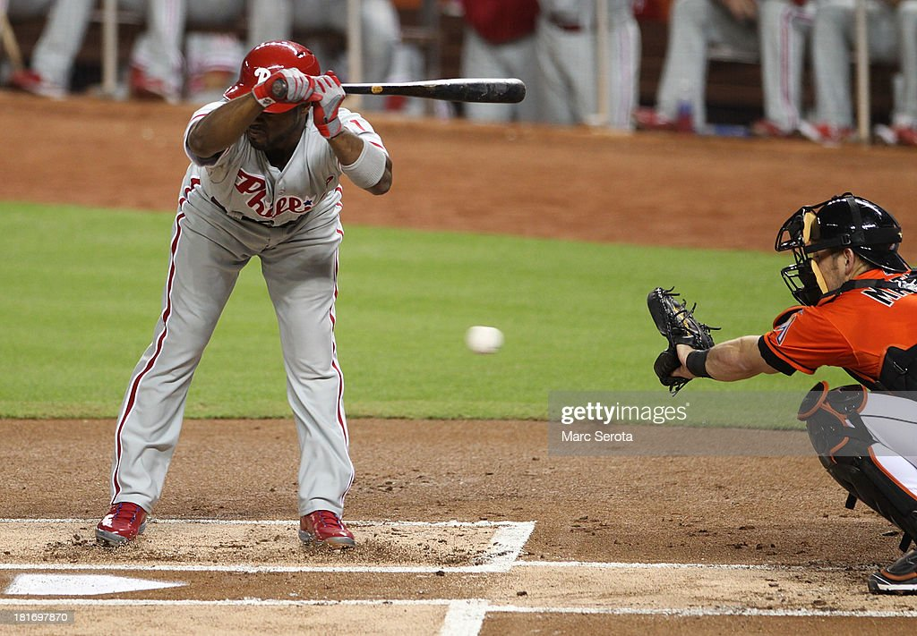 Jimmy Rollins #11 of the Philadelphia Phillies avoids an inside pitch against the Miami Marlins at Marlins Park on September 23, 2013 in Miami, Florida.