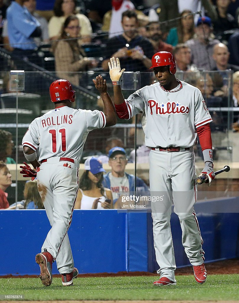 <a gi-track='captionPersonalityLinkClicked' href=/galleries/search?phrase=Jimmy+Rollins&family=editorial&specificpeople=204478 ng-click='$event.stopPropagation()'>Jimmy Rollins</a> #11 of the Philadelphia Phillies celebrates his fifth inning home run against the New York Mets with teammate <a gi-track='captionPersonalityLinkClicked' href=/galleries/search?phrase=John+Mayberry+Jr.&family=editorial&specificpeople=4959058 ng-click='$event.stopPropagation()'>John Mayberry Jr.</a> at Citi Field on September 17, 2012 in the Flushing neighborhood of the Queens borough of New York City.