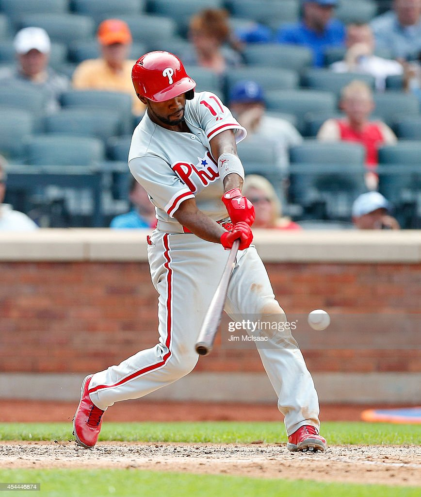 <a gi-track='captionPersonalityLinkClicked' href=/galleries/search?phrase=Jimmy+Rollins&family=editorial&specificpeople=204478 ng-click='$event.stopPropagation()'>Jimmy Rollins</a> #11 of the Philadelphia Phillies connects on a RBI base hit against the New York Mets at Citi Field on August 31, 2014 in the Flushing neighborhood of the Queens borough of New York City. The Mets defeated the Phillies 6-5.