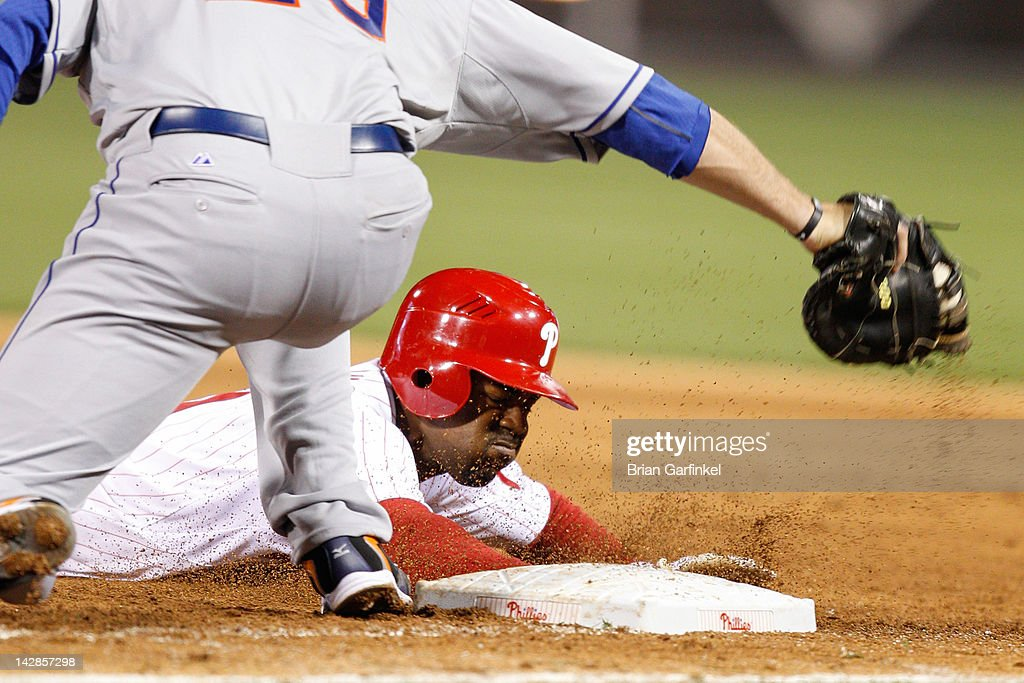 <a gi-track='captionPersonalityLinkClicked' href=/galleries/search?phrase=Jimmy+Rollins&family=editorial&specificpeople=204478 ng-click='$event.stopPropagation()'>Jimmy Rollins</a> #11 of the Philadelphia Phillies dives back to first and stays safe while <a gi-track='captionPersonalityLinkClicked' href=/galleries/search?phrase=Ike+Davis&family=editorial&specificpeople=2349664 ng-click='$event.stopPropagation()'>Ike Davis</a> #29 of the New York Mets attempts to tag him out during the game against the New York Mets at Citizens Bank Park on April 13, 2012 in Philadelphia, Pennsylvania. The Mets won 5-2.